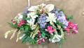 Artificial flower arrangement head stone saddle