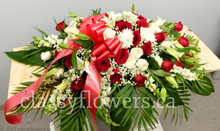 Small size open casket spray with white and red flowers $120