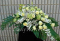 Small size casket spray with mixed flowers $99