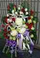 Medium funeral standing flower spay $135