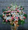 Premium size tribute flower arrangement $135
