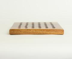 Side view of a small konane board