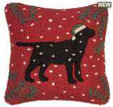 "18"" square hand hooked pillow, made with 100% natural wool. Zippered velveteen backing with poly-fill pillow insert. Designed by Laura Megroz.  Lab lovers and Christmas lovers can unite in a gorgeous hooked wool holiday pillow! A handsome black Labrador retriever in Christmas stocking cap looks grand against red background with pine boughs in corners and snowflakes drifting down."