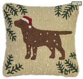 "18"" square hand hooked pillow, made with 100% natural wool. Zippered velveteen backing with poly-fill pillow insert. Designed by Laura Megroz.  Lab lovers and Christmas lovers can unite in a gorgeous hooked wool holiday pillow! A handsome chocolate Labrador retriever in a cheerful red Christmas stocking cap stands out proudly on a beige background with pine boughs in corners and snowflakes drifting down."