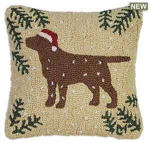 """18"""" square hand hooked pillow, made with 100% natural wool. Zippered velveteen backing with poly-fill pillow insert. Designed by Laura Megroz.  Lab lovers and Christmas lovers can unite in a gorgeous hooked wool holiday pillow! A handsome chocolate Labrador retriever in a cheerful red Christmas stocking cap stands out proudly on a beige background with pine boughs in corners and snowflakes drifting down."""