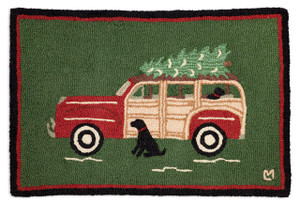 2'x3' hand hooked accent rug. made with 100% natural wool. Designed by Laura Megroz.  This adorable accent rug features a black lab waiting patiently by an old woody wagon, the christmas tree on top is tidings of things to come!