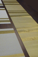 Gold weaved runner with matching placemats