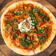 TANDOORI CHICKEN marinated tandoori-spiced chicken, napoli sauce based, baby spinach, mozzarella, cucumber yogurt, fresh chilli, coriander, mint, crispy shallots