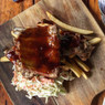 Sticky Maple & Jim Beam Bourbon Pork Ribs Dragons own secret marinade over juicy rack of country swine, coleslaw and fries.