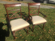 Pair of carved cherry arm chairs
