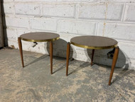 Pair Mcm round side tables with pencil legs
