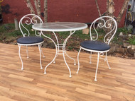 iron bistro set with blue cushions