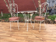 iron bistro set with pink cushions