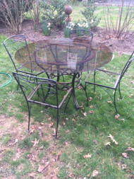 "48"" glass top table and 4 chairs"
