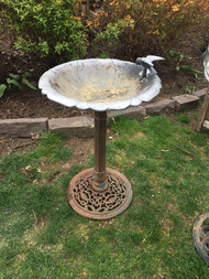 Cast iron bird bath with bird
