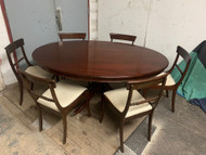 5.5 ft oval mahogany dining table with 6 chairs