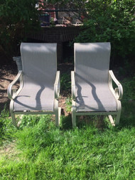 pair of cream patio chairs