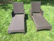 pair of faux wicker outdoor lounge chairs
