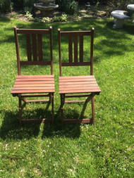 Pair of folding teak chairs