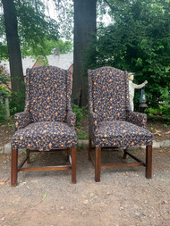 Pair of navy floral print wing back chairs