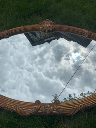 large gold framed mirror