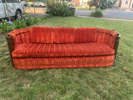 Red and orange vintage velvet sofa