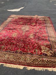 Red worn area rug 9ft x11ft 6in