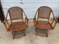 Pair rattan swivel chairs