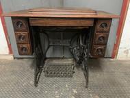 antique Singer sewing cabinet