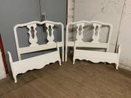 Pair of white twin french beds