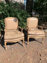 Pair of tan leather like french chairs