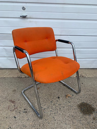 Orange mid century chrome chair with arms