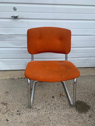 Orange mid century chrome chair