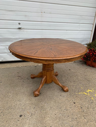 "48"" round claw foot oak table"