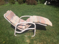 Pale pink plastic pipe gravity chair with cushion