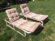 Vintage pale pink plastic tube lounge chairs with cushions