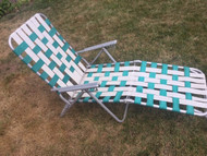 Vintage aluminum teal and white lounge chair