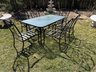 Bronze patio table and six chairs