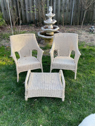 Pair of wicker arm chairs with ottoman