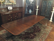 Beautiful 10ft banded mahogany dining room table by Baker Furniture.