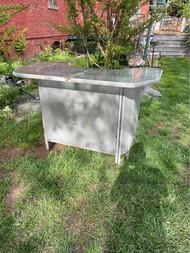 Gray glass top patio bar