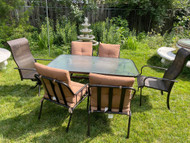 Bronze finish glass top patio table and 6 chairs with cushions