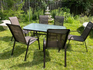 Bronze finish glass top patio table and 6 sling chairs