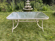 Beige glass top patio table