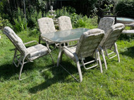 Beige patio table with six reclining chairs