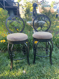 Pair of counter height metal swivel stools