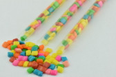 Delicious and colorful coated bubble gums. These candies come cut into a square and inside a transparent plastic tube.