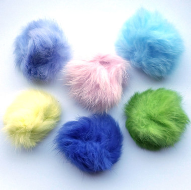 Flying Fuzz Balls in Pastel Baby Colors
