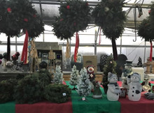 Wreaths and kissing balls, both plain and decorated, Christmas trees and cemetery baskets -- and lots of other decorations. Toys for pets and kids, and gifts for adults, too.