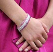Swarovski Crystal Stretch Bracelets shown in (top to bottom) Rose, White Opal, Crystal (Clear) & Fuchsia in Silver.